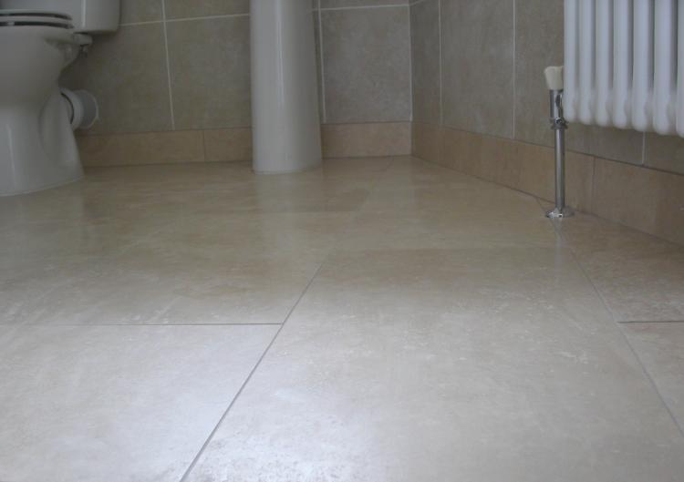 Travertine tiles, en-suite shower and W.C