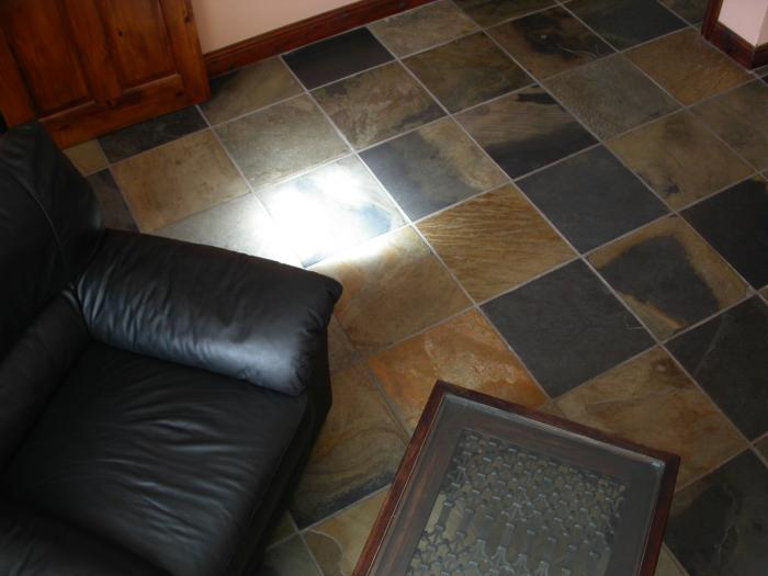 Living room floor set with Calico slate tiles