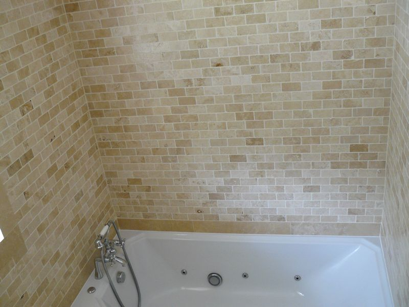 Travertine tiles, bathroom and w.c with granite worktop