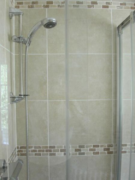 Travertine tiles, en-suite shower and W.C